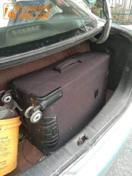 失物招领:好心人拾获红色行李箱